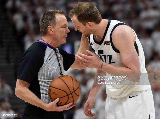 Official Bill Spooner explains a foul call to Joe Ingles of the Utah Jazz in the second half during Game Four of Round One of the 2018 NBA Playoffs...