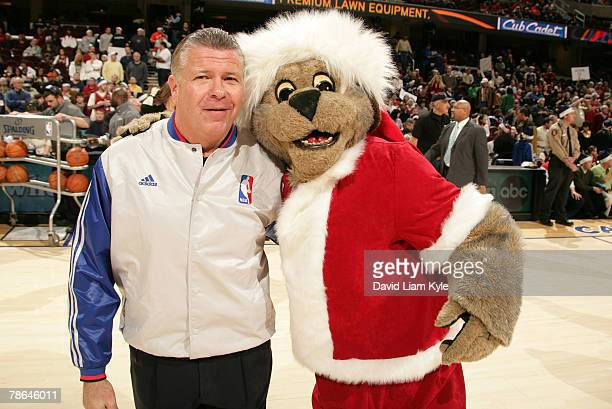 Official Bob Delaney takes time for Cleveland Cavaliers mascot Moondog in a Santa oufit prior to the game against the Miami Heat on December 25 2007...