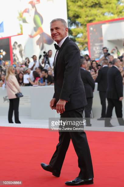 Official Competition jury member Christoph Waltz walks the red carpet ahead of the opening ceremony and the 'First Man' screening during the 75th...