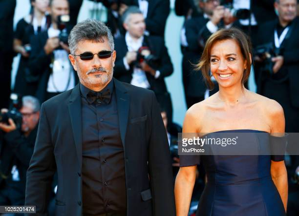 Official Competition jury member Paolo Genovese and Federica Rizzo walk the red carpet ahead of the opening ceremony and the 'First Man' screening...