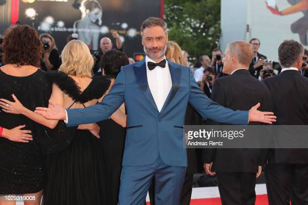 Official Competition jury member Taika Waititi walks the red carpet ahead of the Award Ceremony during the 75th Venice Film Festival at Sala Grande...