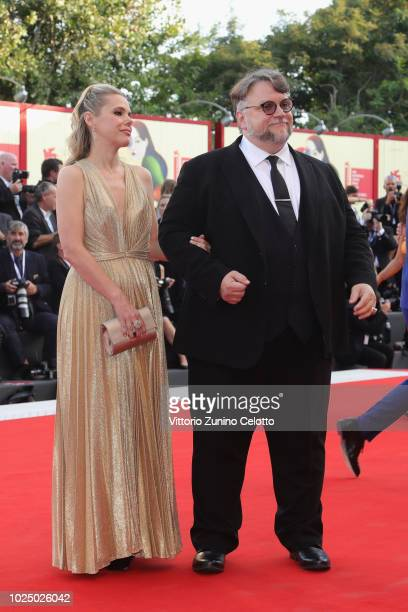 Official Compettion jury president Guillermo Del Toro and Kim Morgan walk the red carpet ahead of the opening ceremony and the 'First Man' screening...