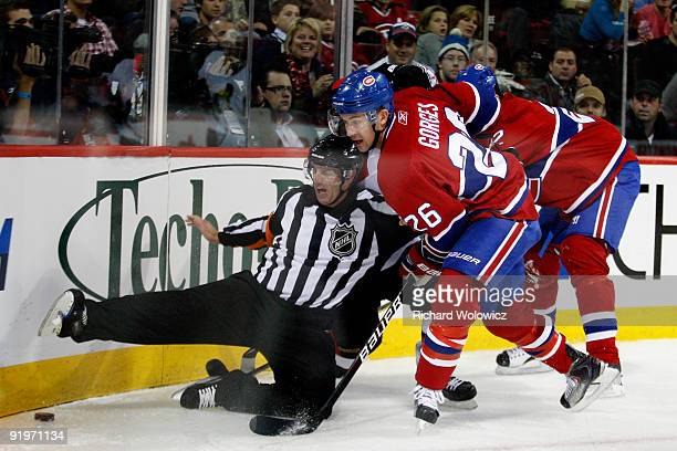Official Dean Morton gets knocked down by Josh Gorges of the Montreal Canadiens during the NHL game against the Ottawa Senators on October 17 2009 at...
