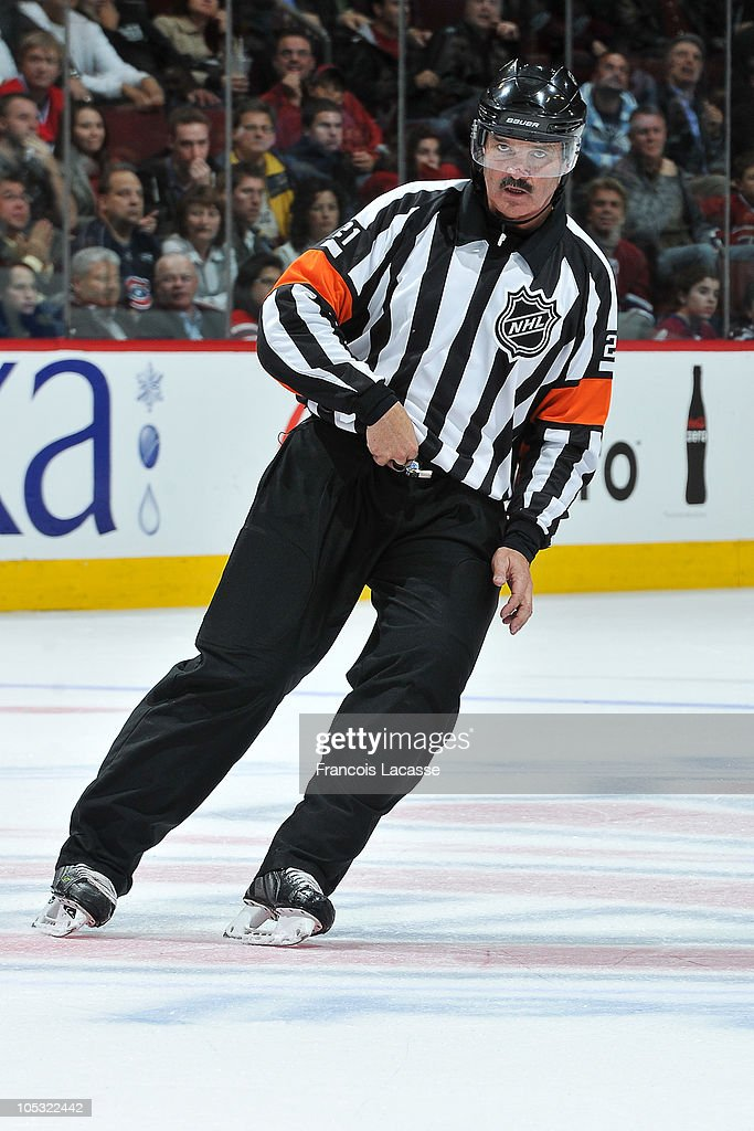 Official Don VAN Massenhoven prepares to announce a decision during the NHL game between the Montreal Canadiens and the Tampa Bay Lightning on October 13, 2010 at the Bell Centre in Montreal, Quebec, Canada.
