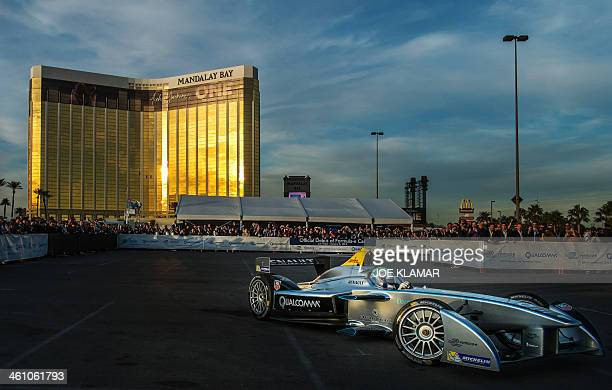Official driver Lucas di Grassi demonstrates Formula Es new fullyelectric race car the SparkRenault SRT_01E entertaining crowds with a highspeed...