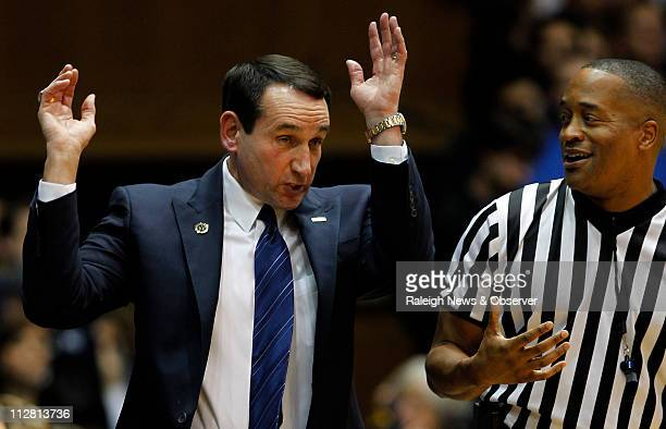 Official Earl Walton laughs as Duke coach Mike Krzyzewski gyrates on the sidelines during the first half against Elon at Cameron Indoor Stadium in...
