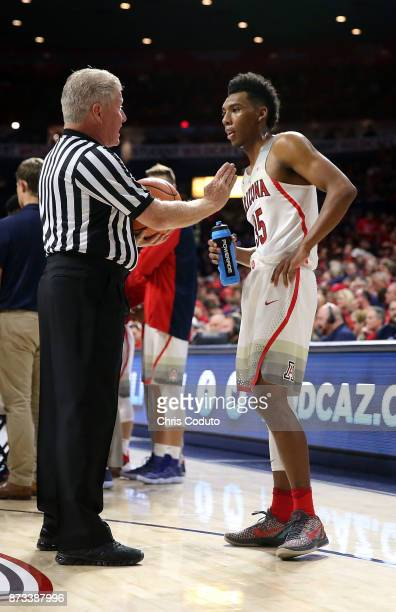 Official Eric Curry talks with Allonzo Trier of the Arizona Wildcats during the first half of the college basketball game against the UMBC Retrievers...