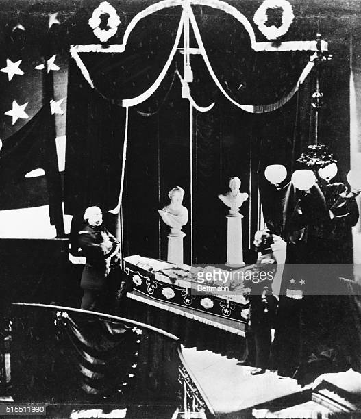 Official escorts stand alongside the body of Abraham Lincoln which lays in an open coffin on display for public viewing inside New York City Hall...
