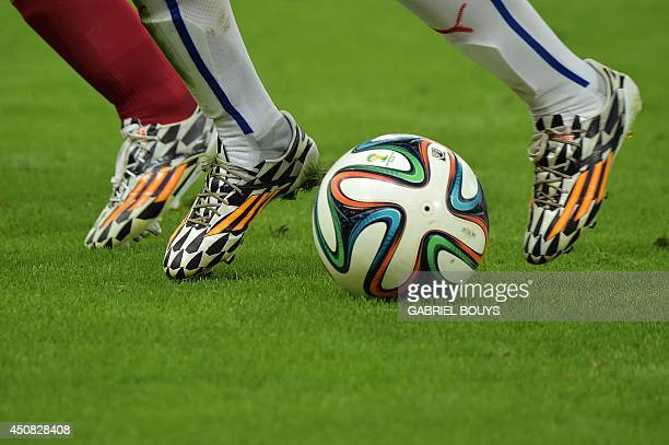 Official FIFA ball Brazuca is played during a Group B football match between Spain and Chile in the Maracana Stadium in Rio de Janeiro during the...