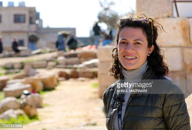 Official Giorgia Cesaro, speaks to AFP at the site where workers employed by a pilot project run by the UN cultural agency UNESCO, restore an ancient...