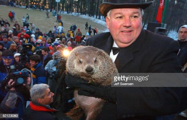Official groundhog handler Bill Deeley holds Punxsutawney Phil as the weather prediction proclimation is read February 2 2005 in Punxsutawney...