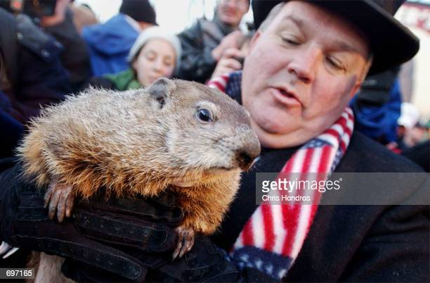 Official Groundhog Handler Bill Deeley holds Punxsutawney Phil in front of the crowd February 2 2002 after the groundhog made his yearly weather...