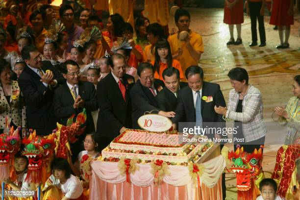 Official guests cutting the Birthday Cake to celebrate 10th Anniversary of the establishment of the HKSAR while ten thousand young people from the...