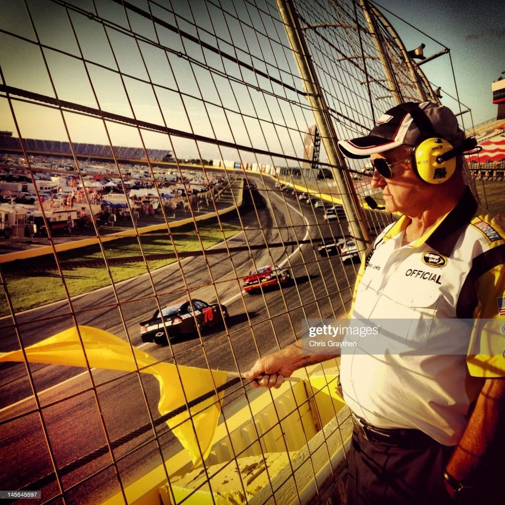 A NASCAR official holds a caution flag during the NASCAR Sprint Cup Series Coca-Cola 600 at Charlotte Motor Speedway on May 27, 2012 in Concord, North Carolina.