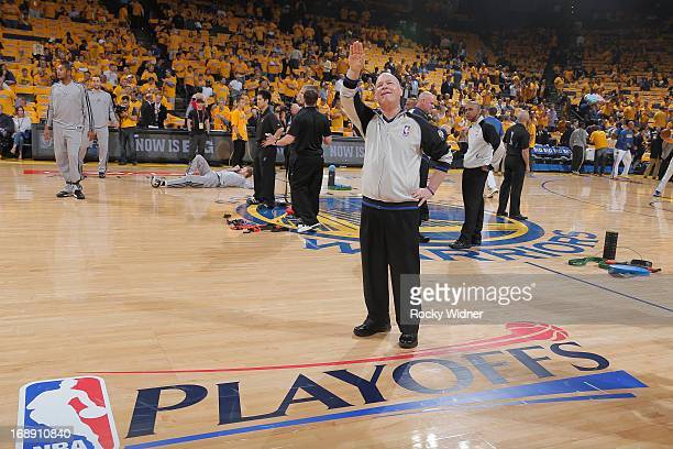NBA official Joey Crawford waves to the crowd before Game Six of the Western Conference Semifinals between the San Antonio Spurs and the Golden State...