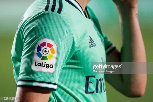 Official logo of La Liga on the Adidas Real Madrid shirt during the La Liga Santander match between Granada v Real Madrid at the Estadio Nuevo Los...
