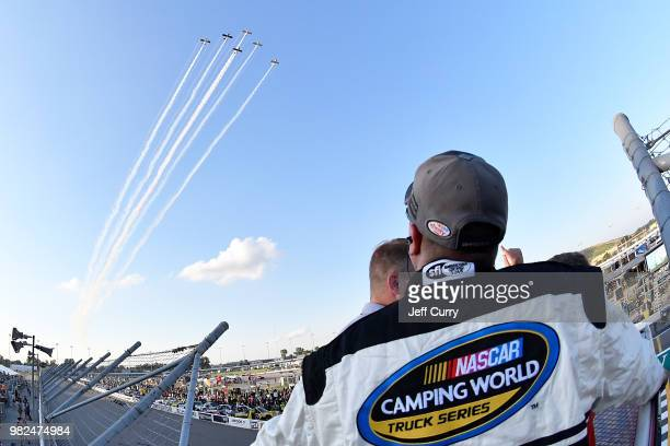 NASCAR official looks on during a fly over prior to the start of the NASCAR Camping World Truck Series Villa Lighting delivers the Eaton 200 at...