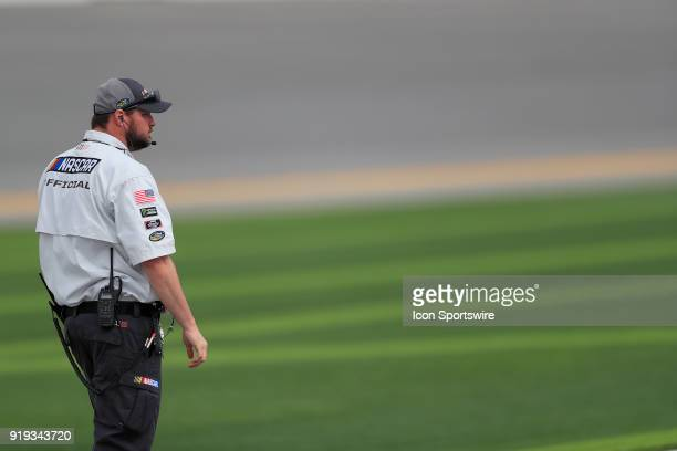 Official looks on during qualifying for the POWERSHARES QQQ 300 NASCAR Xfinity Series race on February 17 at the Daytona International Speedway in...