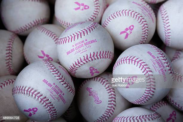 Official Major League Baseball balls with pink stitching and lettering to observe Mother's Day are seen during the game between the Colorado Rockies...