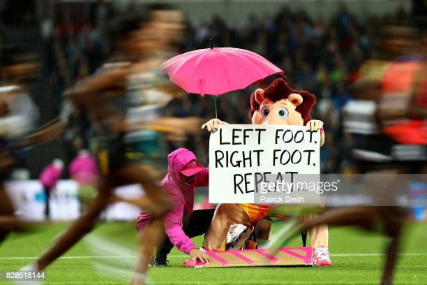 Official mascott Hero the Hedgehog leaves signs for athletes as he watches on from the infield during day six of the 16th IAAF World Athletics...
