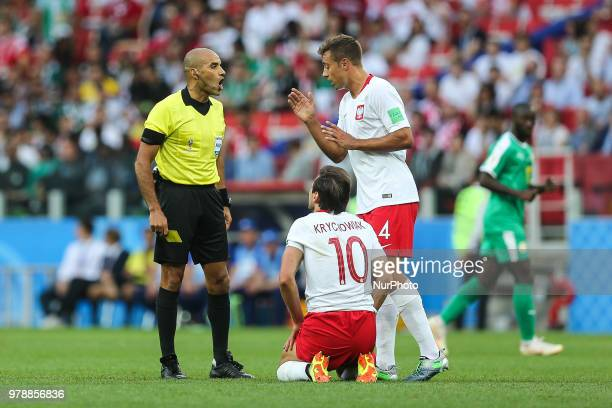 official Nawaf ShukrallaGrzegorz Krychowiak Thiago Cionek during the 2018 FIFA World Cup Russia group H match between Poland and Senegal at Spartak...