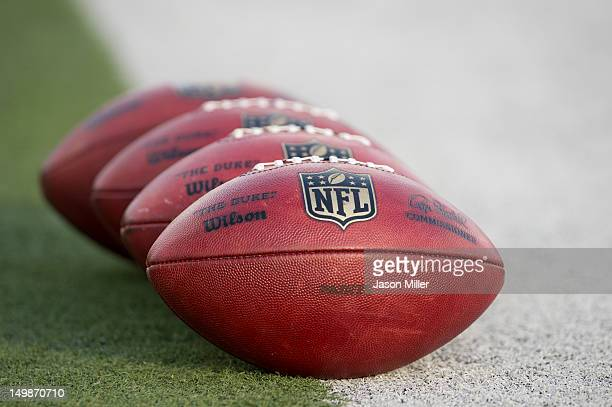Official NFL footballs sit on the sideline prior to the start of the game between the New Orleans Saints and the Arizona Cardinals during the Pro...