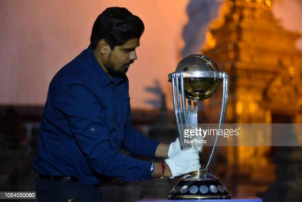 Official of ICC arranging the 2019 ICC Cricket World Cup trophy infront Swayambhunath Stupa or Monkey Temple during a country tour in Kathmandu Nepal...