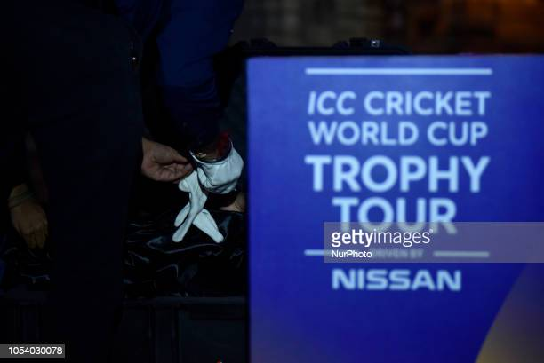 Official of ICC puts gloves on to arrange the 2019 ICC Cricket World Cup trophy infront Swayambhunath Stupa or Monkey Temple during a country tour in...