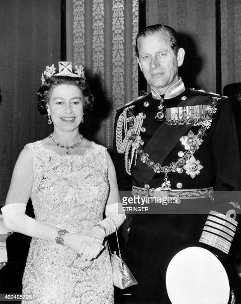Official photo taken on November 3 1972 shows Britain's Queen Elizabeth II wearing the George IV State Diadem diamond tiara on British and...