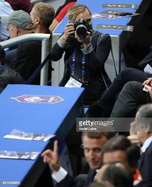 Official photographer of French President Emmanuel Macron Nathalie Bauer in action during the FIFA 2018 World Cup Qualifier between France and...