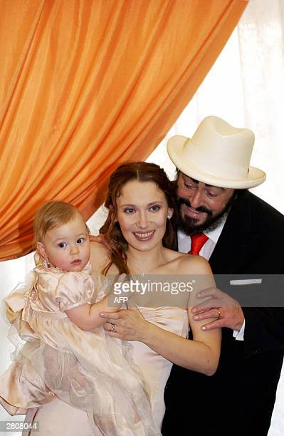 Official picture of the famous Italian tenor Luciano Pavarotti and Nicoletta Mantovani with their 11 month old daughter, Alice after their wedding...