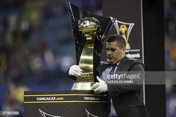 A CONCACAF official places the Champions League trophy on the podium after Club America's victory over the Montreal Impact in the CONCACAF Champions...