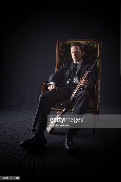 Official Portrait Of A Gangster With His Gun