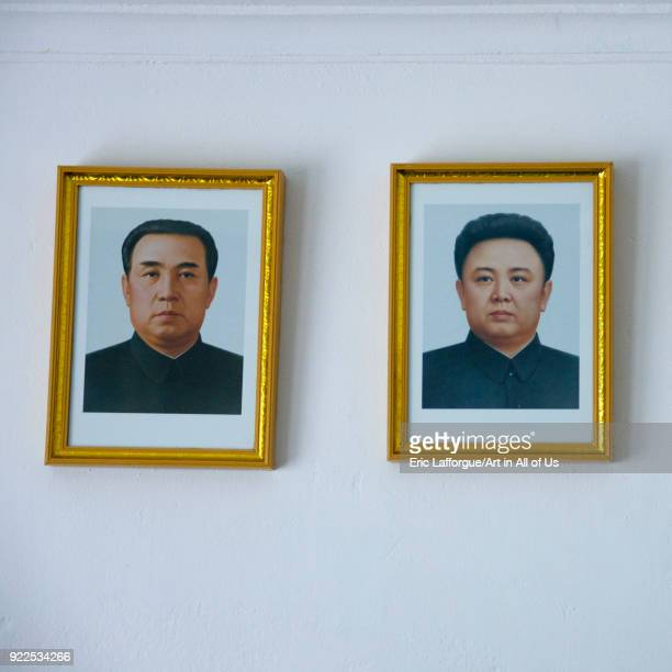 Official portraits of Kim il Sung and Kim Jong il in a home, South Pyongan Province, Chongsan-ri Cooperative Farm, North Korea on May 16, 2009 in...