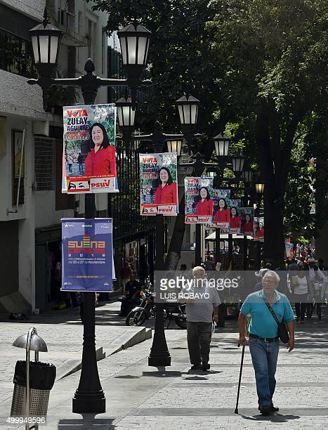 Official propaganda is seen on Caracas streets on December 4 2015 For the first time in 16 years of 'Bolivarian revolution' under late president Hugo...