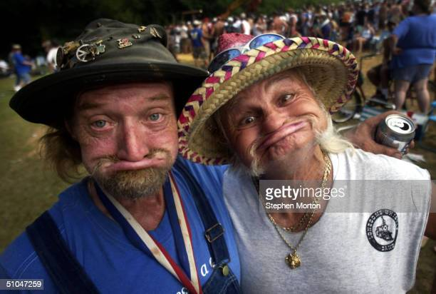 Official Redneck Game Mascot Randy Elbow Tidwell and Frank Freight Train Mills pose for a photo July 10 2004 during the 9th Annual Summer Redneck...