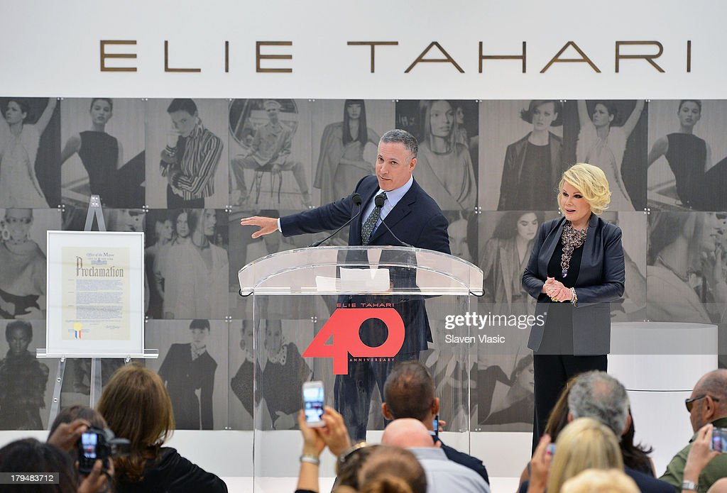 NYC official Robert Goldrich and TV personality Joan Rivers attend New York City's Elie Tahari Day at Elie Tahari Pop-up Store on September 4, 2013 in New York City.