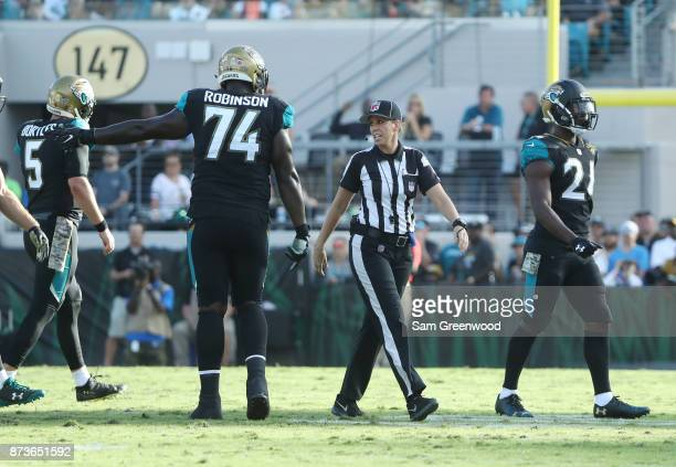 NFL official Sarah Thomas is shown on the field during the game between the Los Angeles Chargers and the Jacksonville Jaguars at EverBank Field on...