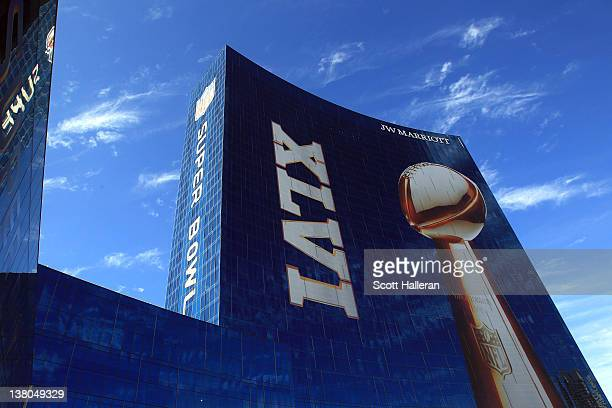 Official signage of the Lombardi Trophy and Super Bowl XLVI is seen on the exterior of the JW Marriott Indianapolis which is serving as the Super...