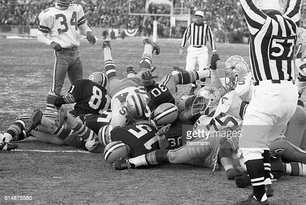 NFL CHAMPIONSHIPGREEN BAY WINSC Official signals touchdown as Packers' Bart Starr plunges for line for winning TD in 4th qtr of NFL Championship game...