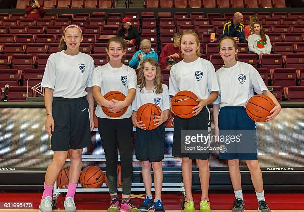 Official Stanford Cardinal ball girls pose during the regular season game between Oregon State University Beavers and the Stanford Cardinals women...