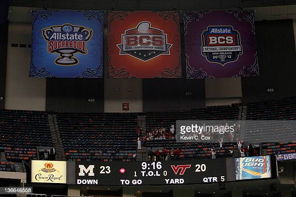 Official Sugar Bowl signage BCS Championship Game signage and BCS Bowl Series signage hangs over the scoreboard which declares the Michigan...