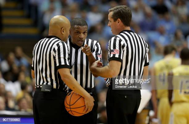 Official Ted Valentine talks to Bill Covington Jr and Jeb Hartness during the game between the North Carolina Tar Heels and Georgia Tech Yellow...