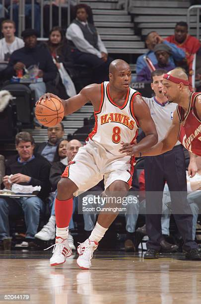 Official Tim Donaghy watches as Antoine Walker of the Atlanta Hawks is defended by Drew Gooden of the Cleveland Cavaliers during the game at Philips...
