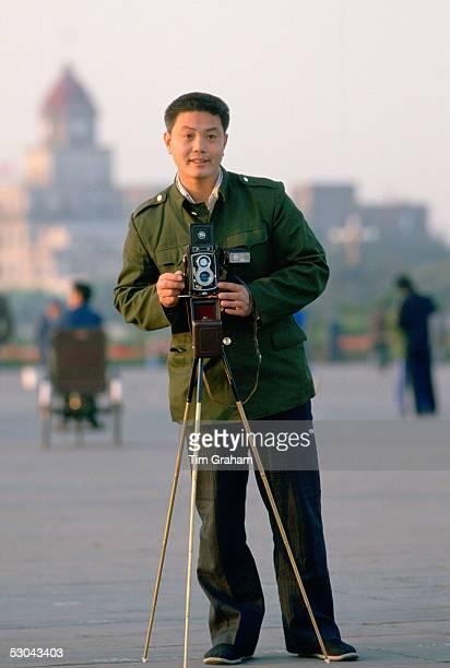 Official tourist photographer Tianenmen Square Peking China