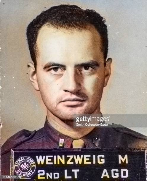 Official United States Signal Corps portrait taken during World War 2 of Jewish soldier 2nd Lieutenant Max Warren with a severe facial expression and...