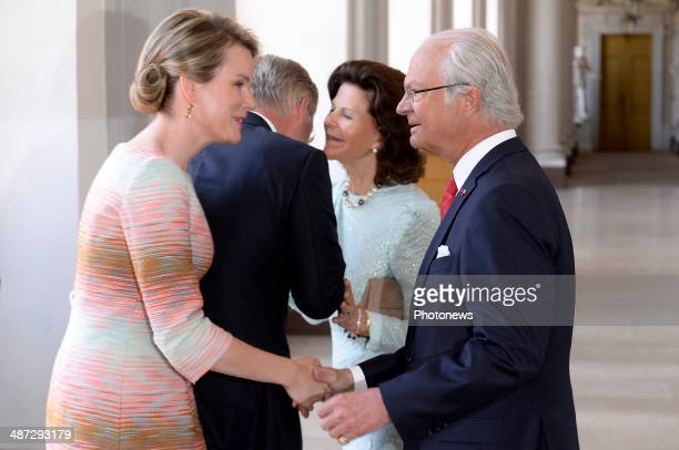 Official visit of Belgian Sovereigns to Sweden on April 29 2014 in Stockholm Sweden Queen Mathilde and King Philippe pictured with King Carl Gustaf...