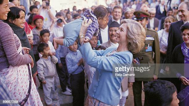 Official visit of the King adn Queen of Spain to Nepal The queen Sofia gets a boy in arms