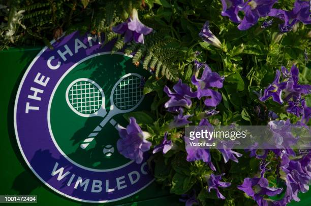 Official Wimbledon branding amongst colour coordinated petunias on day twelve of the Wimbledon Lawn Tennis Championships at the All England Lawn...