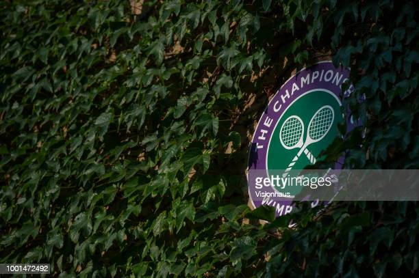 Official Wimbledon branding with surrounded by ivy on day twelve of the Wimbledon Lawn Tennis Championships at the All England Lawn Tennis and...